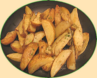 oven fries, sliced potatoes in a tray with minimal oil