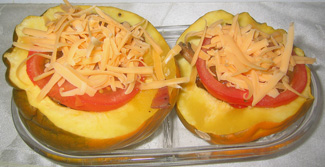Acorn squash topped with tomato & cheese