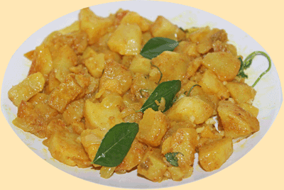 A plate of delicious Potato Curry cooked in the microwave in 12.5 minutes