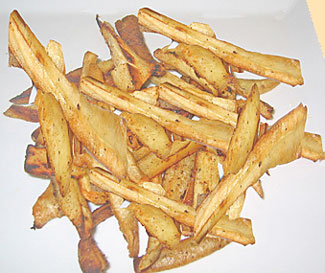 a portion of parsnips fries on a plate