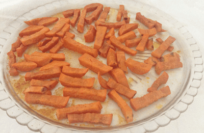a dish of delicious sweet potato fries baked in the microwave